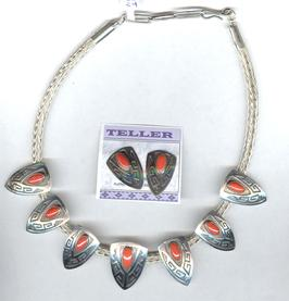 Coral necklace by Everett and Mary Teller on woven silver chain.  Matching earrings.